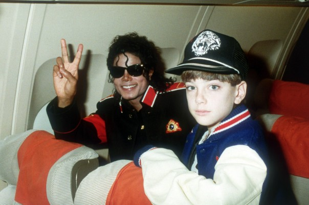 Michael Jackson with 10 year old Jimmy Suchcraft on the tour plane